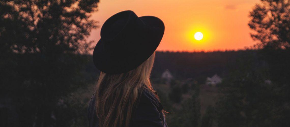 Woman hat sunset